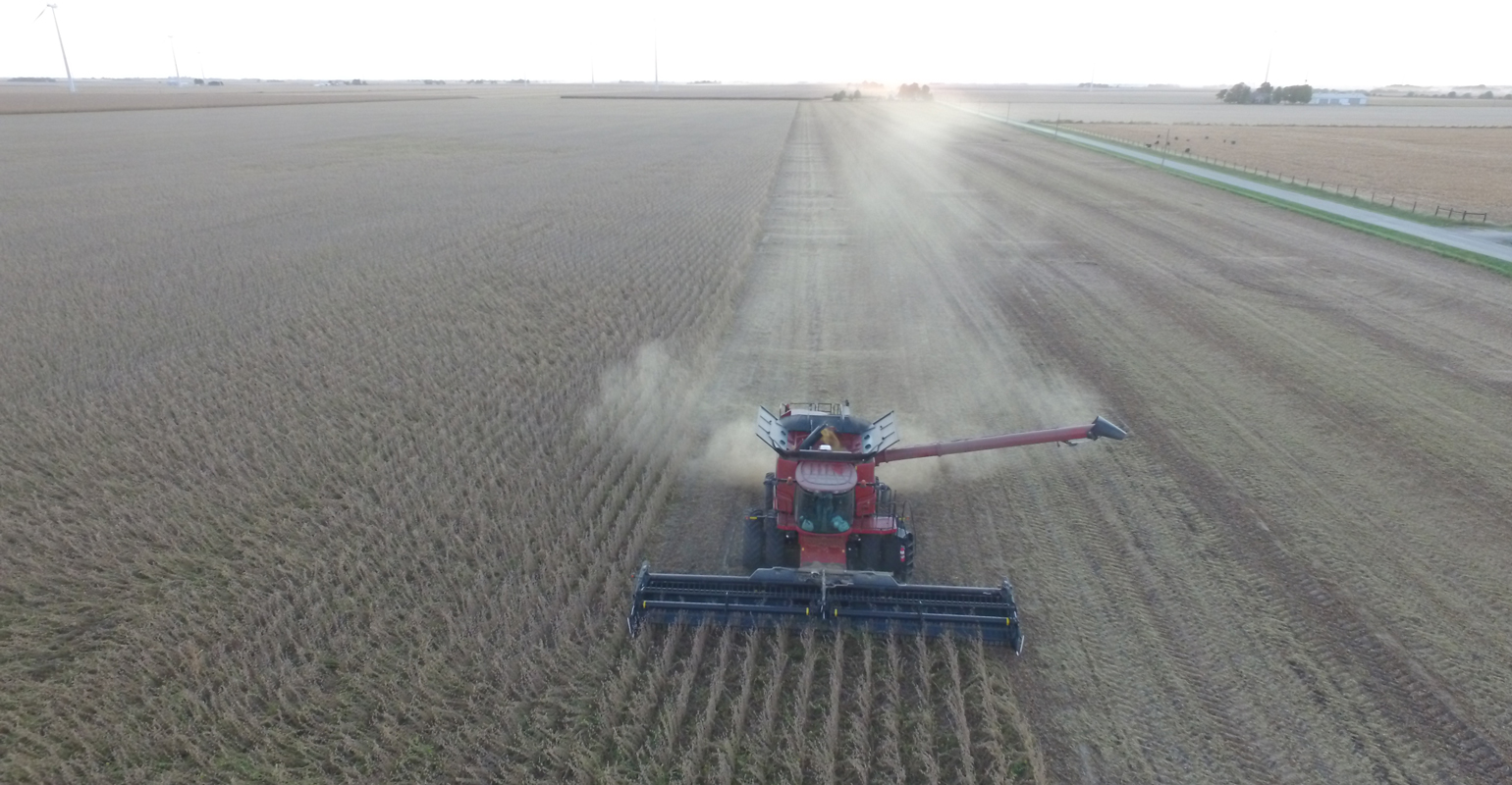 aerial photo of combine harvesting beans