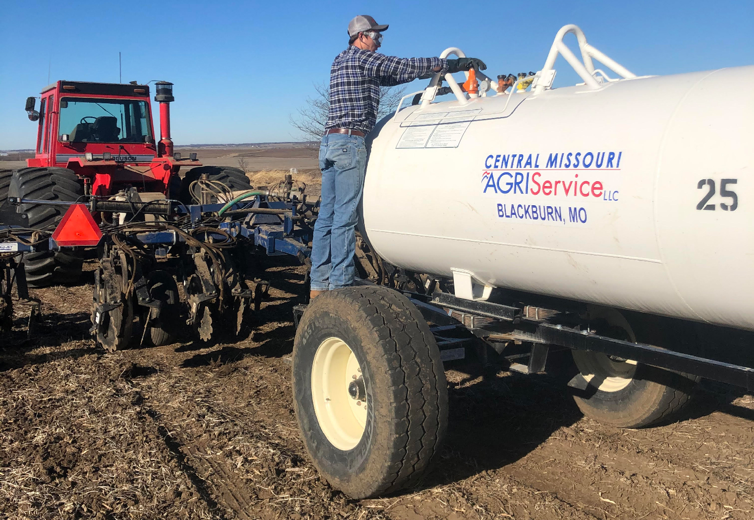 Jacob Dierking checking anhydrous tank
