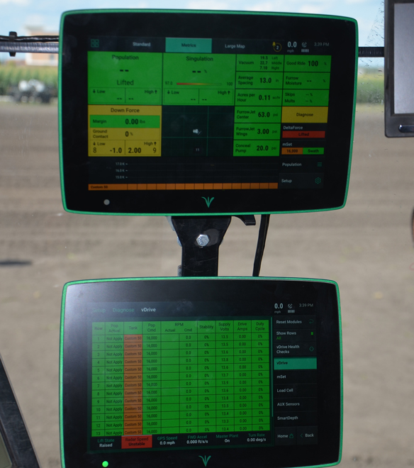 2 10-inch Precision Planting 20/20 Generation 3 display screens paired in cab