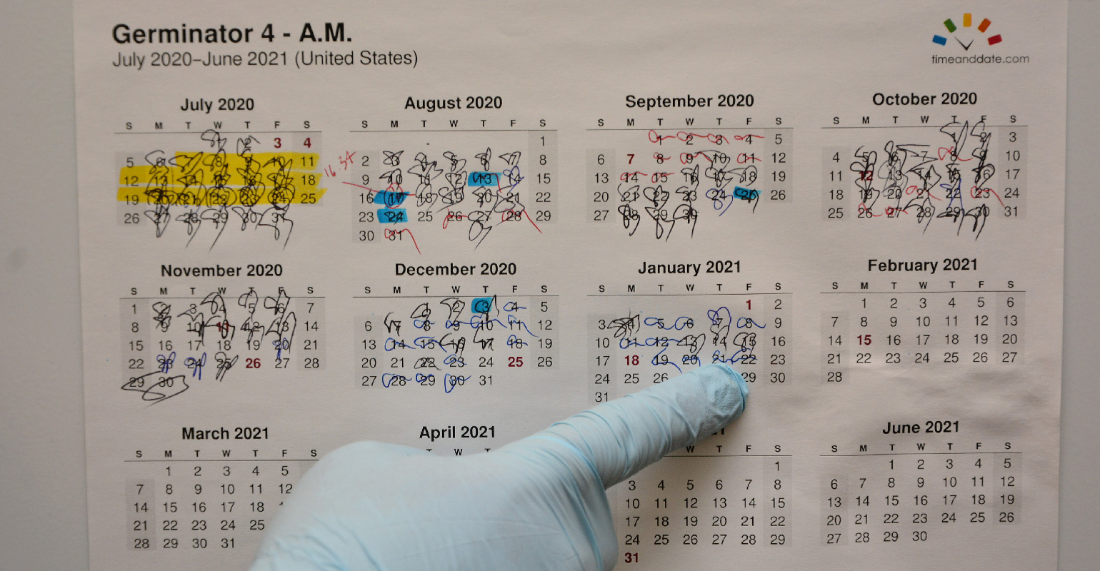 calendar on door of germinator at MCIA lab