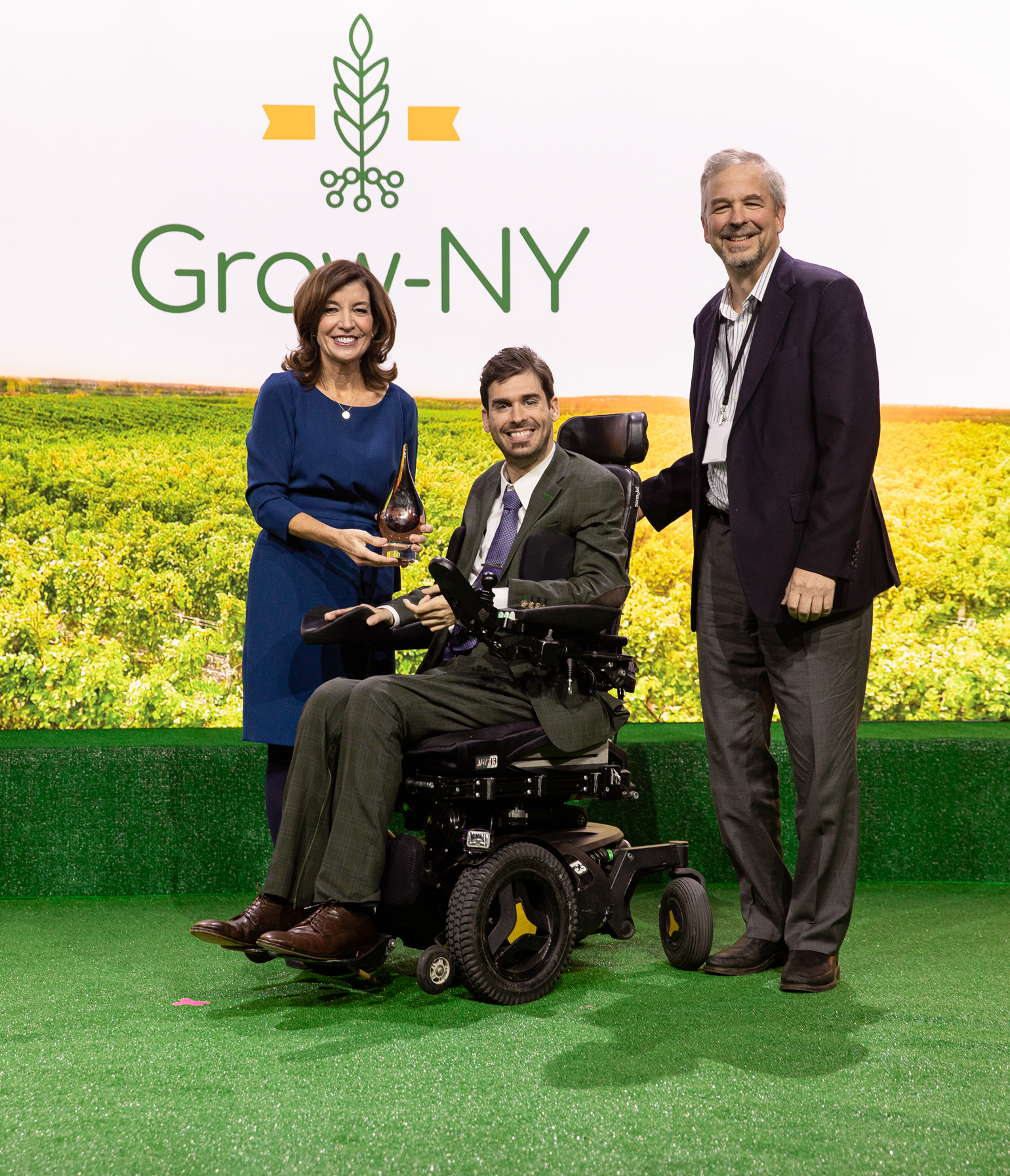 Adam Fine and Mike Winch of Dropcopter receive a Grow-NY award from Kathy Hochul, lieutenant governor of New York