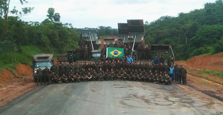 Brazilian engineer battalions celebrate the completion of paving operations of highway BR-163.