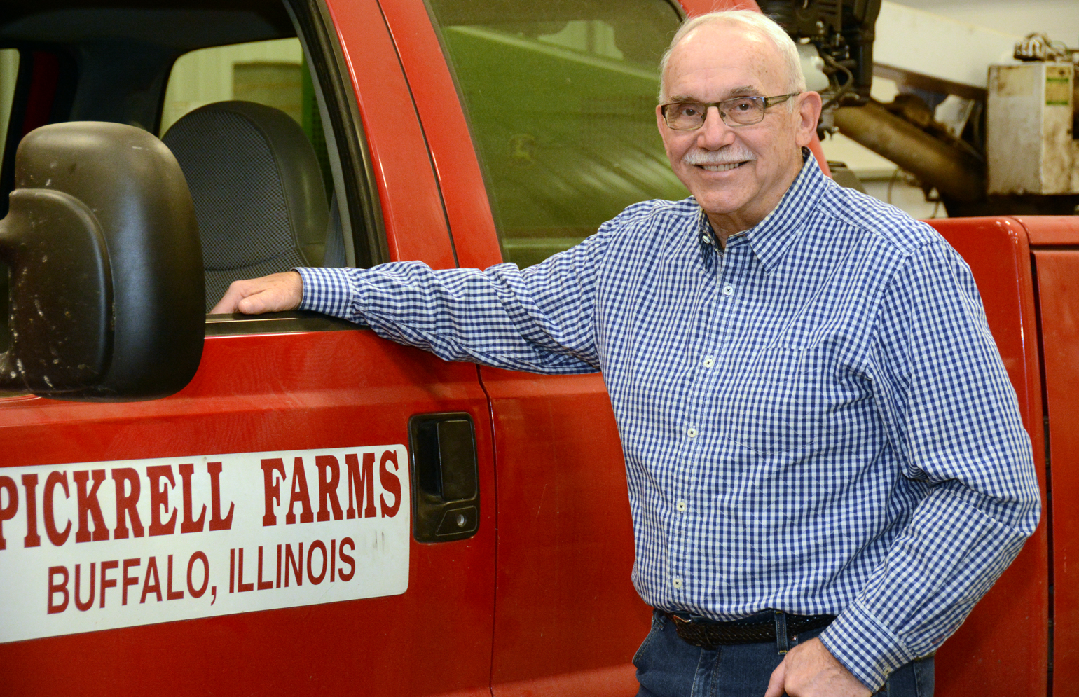 Joe Pickrell standing next to Pickrell Farms truck