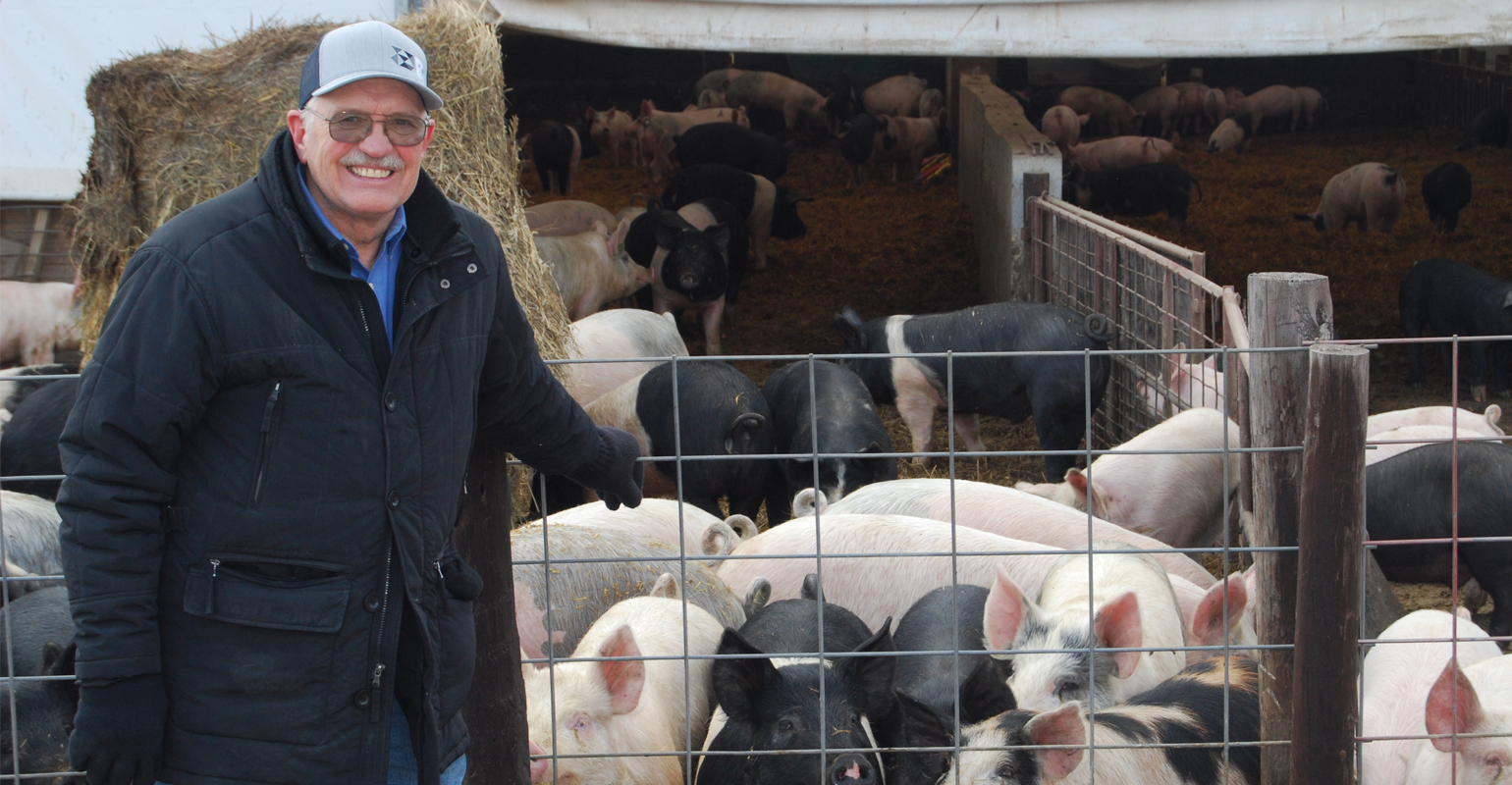 Ron Rosmann with dairy cows