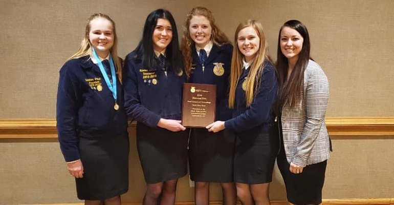 FFA members Christina Greuel, Elizabeth Saewert, Anna Stoppleworth, Madi Olien, and teacher Breanna Bregel