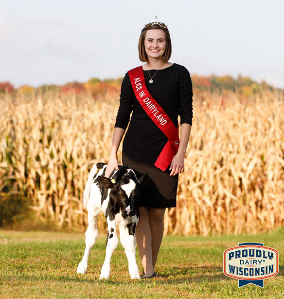 Alice in Dairyland, Julia Nunes, standing with dairy cow