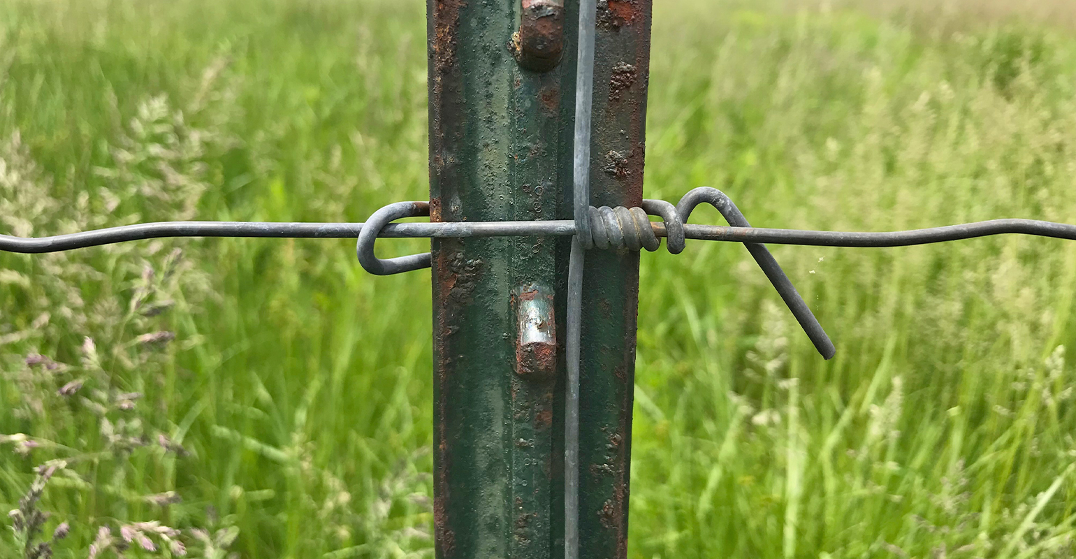 wire clip wrapped to secure fence