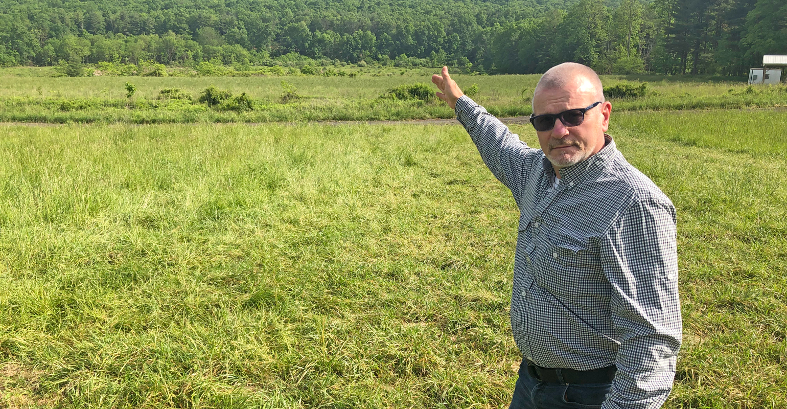 Brian Miller points to future site of the Sustainable Resource Facility