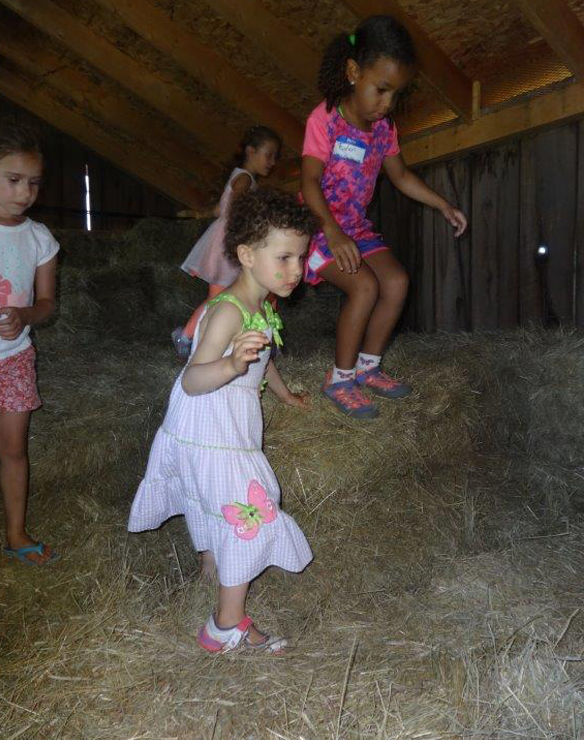 farm kids have taken playing in the hay