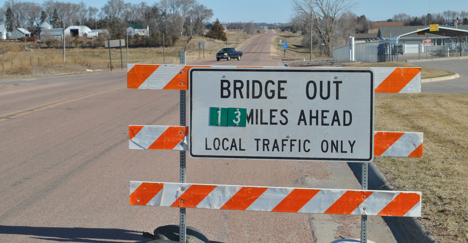 Bridge out 13 miles ahead sign