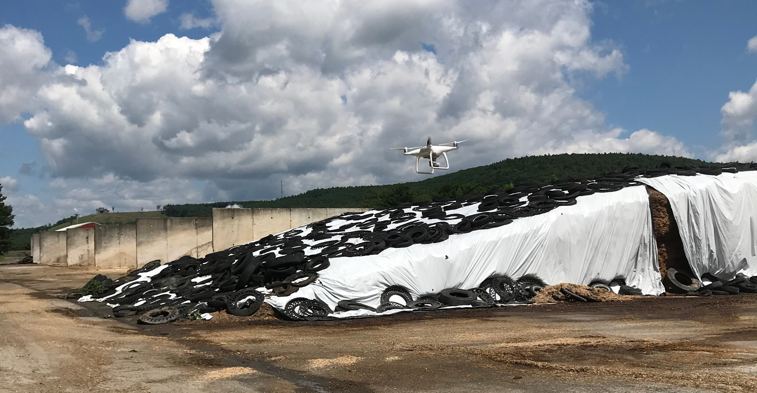 An Aurox drone performs a lower-accuracy flight over feed in a bunk silo