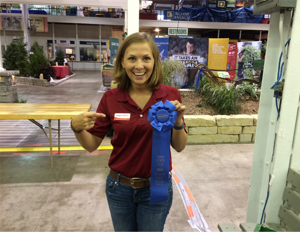 Meaghan Anderson holding blue ribbon for weed ID contest
