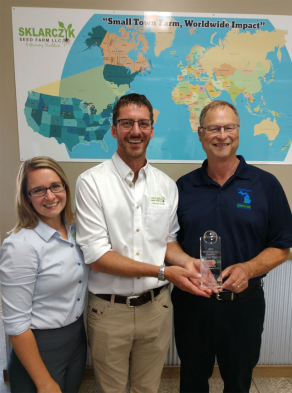 Sklarczyk Seed Farm is the 2019 Ag Exporter of the Year. Pictured are (from left) Alison Sklarczyk, Ben Sklarczyk and MDARD Director Gary McDowell.