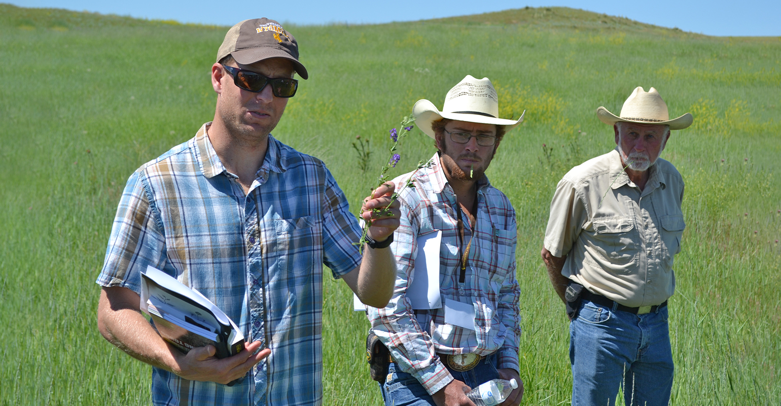 3 men presenting at grazing workshop