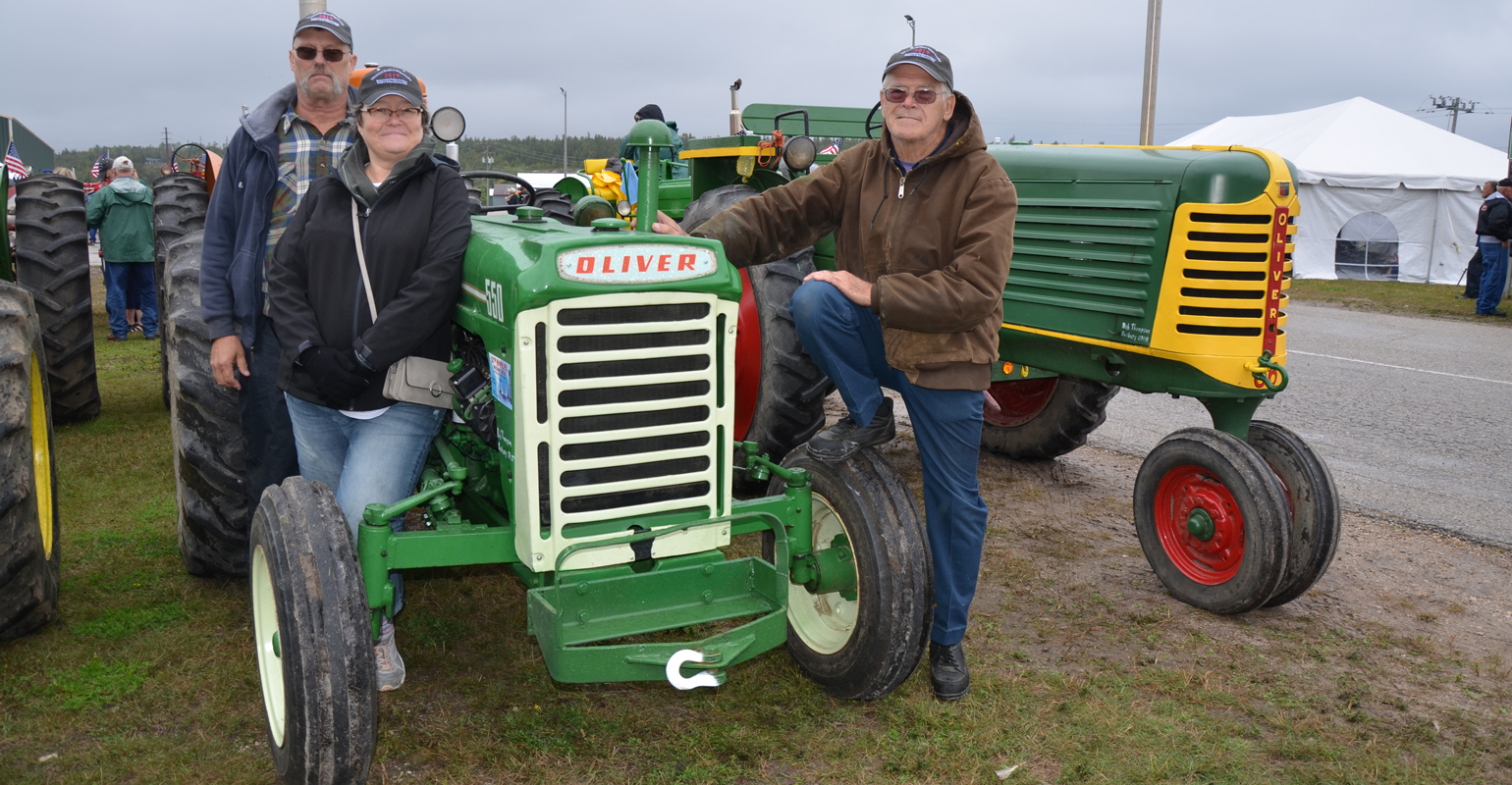 Mike, Theresa and Bob Thompson with their tractors