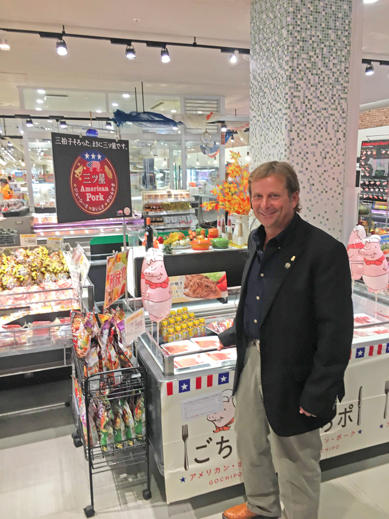 Jay Fischer peruses a meat display in a Japanese grocery store