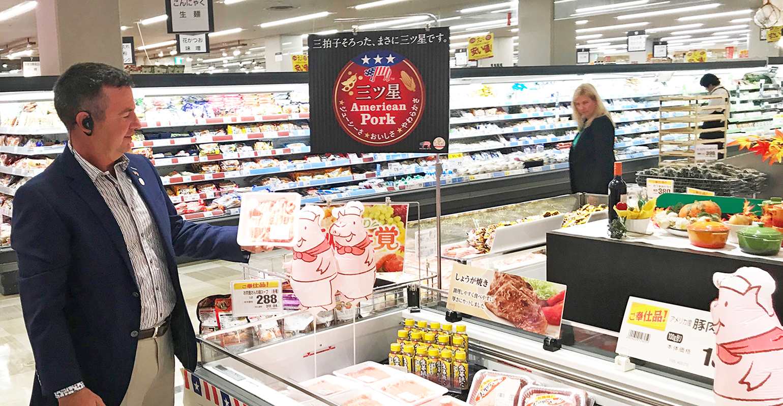 Tim Chancellor examines a U.S. pork promotional display in Japan