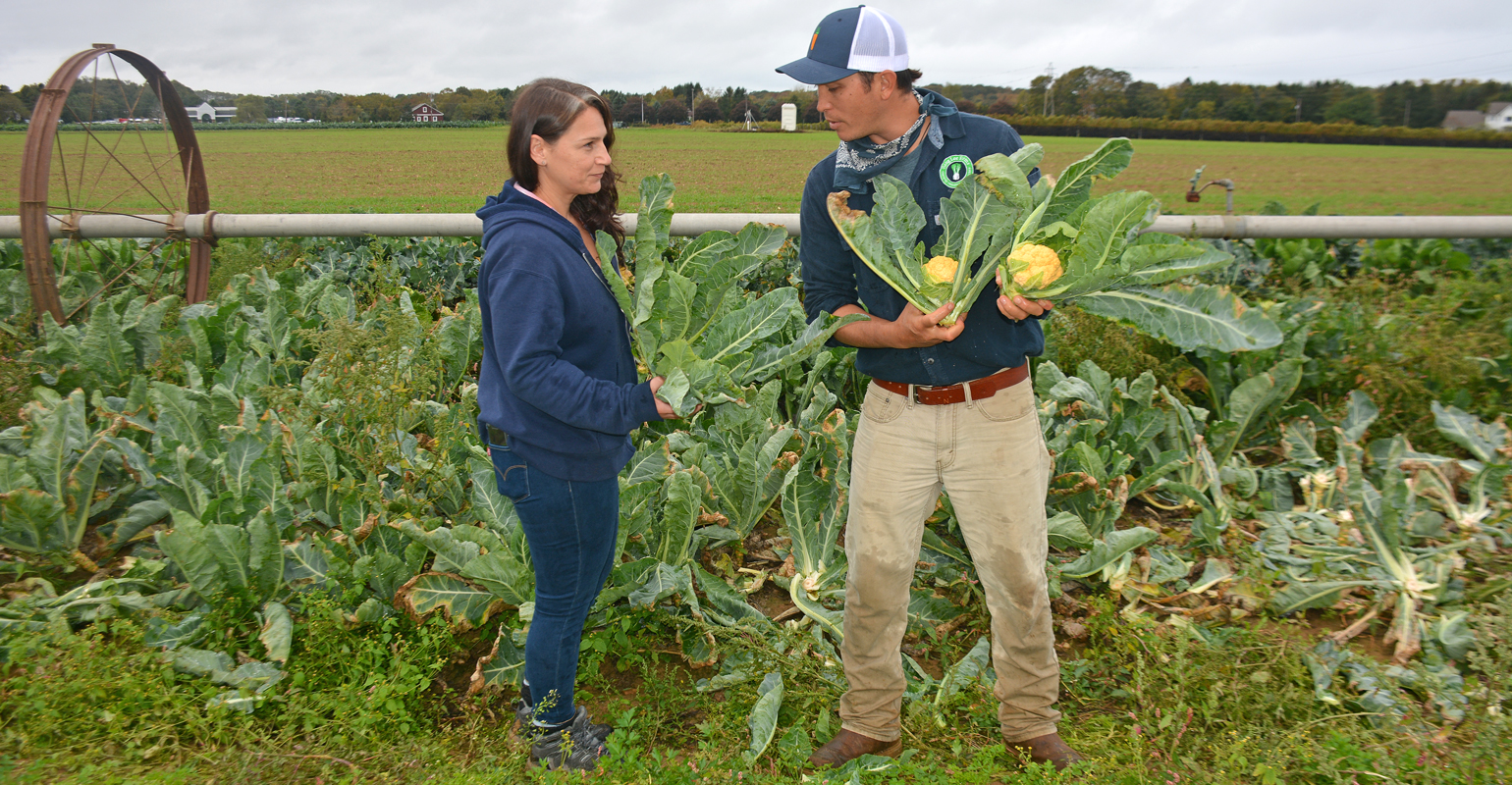 Lee and Ann Marie Calabro of the Suffolk County Soil & Conservation District talk on the farm