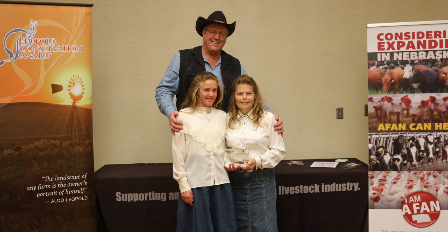 Russ, Angela and Cheyenne Sundstrom from Broken Box Ranch in Moorefield, Nebraska with their Leopold Conservation Award