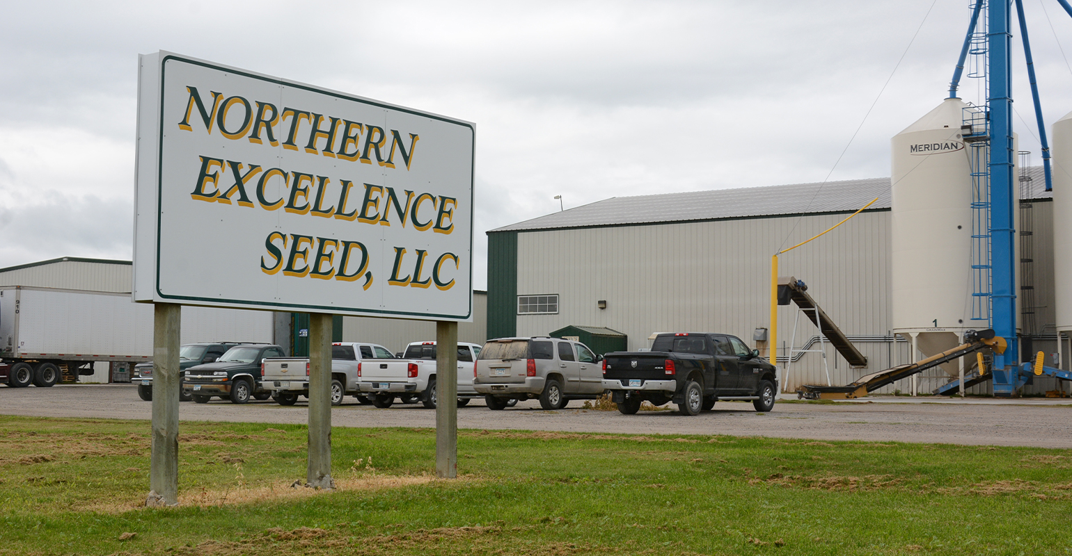 signage and exterior view of Northern Excellence plant and warehouses