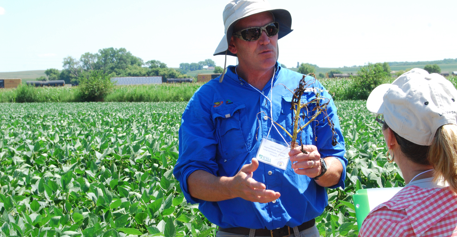 : John Swalwell, agronomist with Asgrow/Dekalb on the Harrison County pest resistance project team, was one of the team members who answered questions at last summer's plot tour