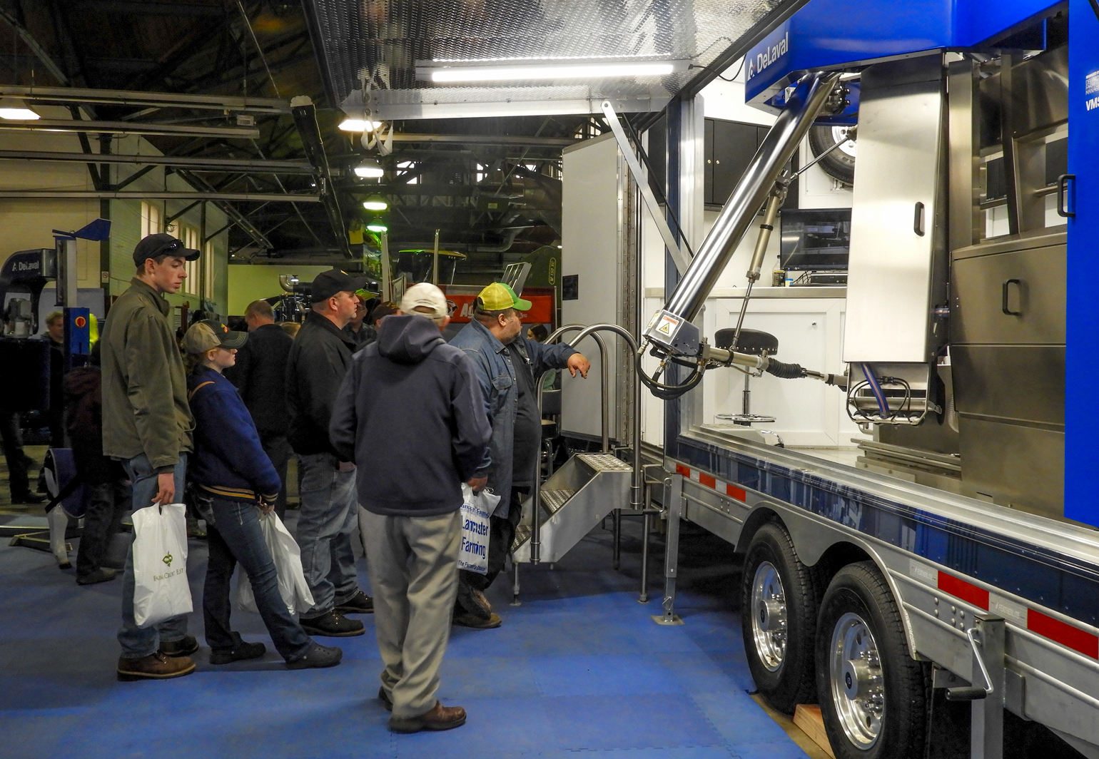 Farmers look at the latest in robotic milking technology at the New York Farm Show