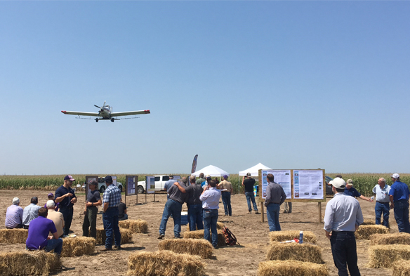 aerial applicator interseeding cover crops into the field at water tech farm field day