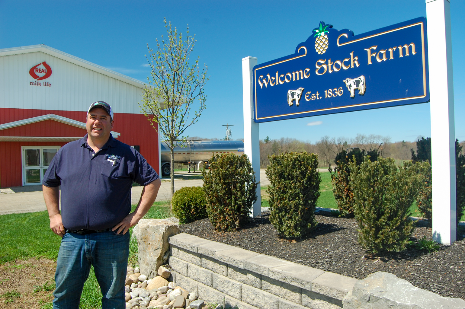 Neil Peck stands outside at his Welcome Stock Farm