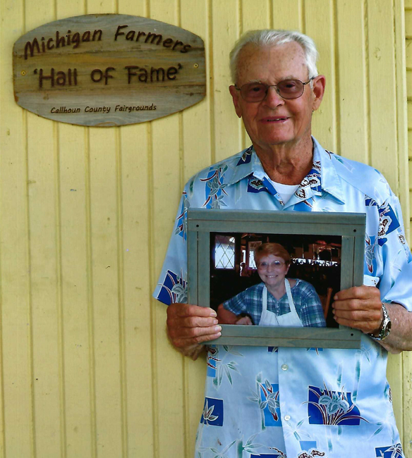 Robert Crane holds a pictured of his late wife, Luetta