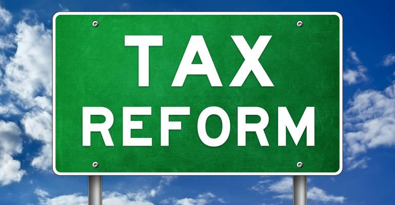 Green highway sign reads 'tax reform'