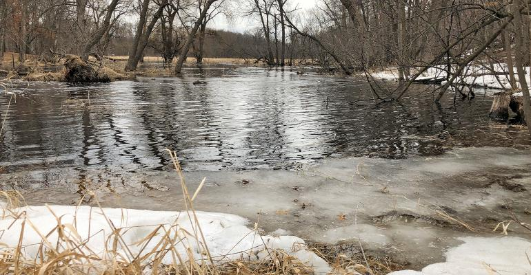 ice and snow on the banks of a creek/ RUNOFF HAPPENS: Data from Discovery Farms in Minnesota and Wisconsin shows that runoff usually happens during two time periods — during snowmelt from February to April and during heavy rains falling from May through J