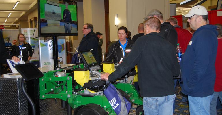 men at farm equipment show