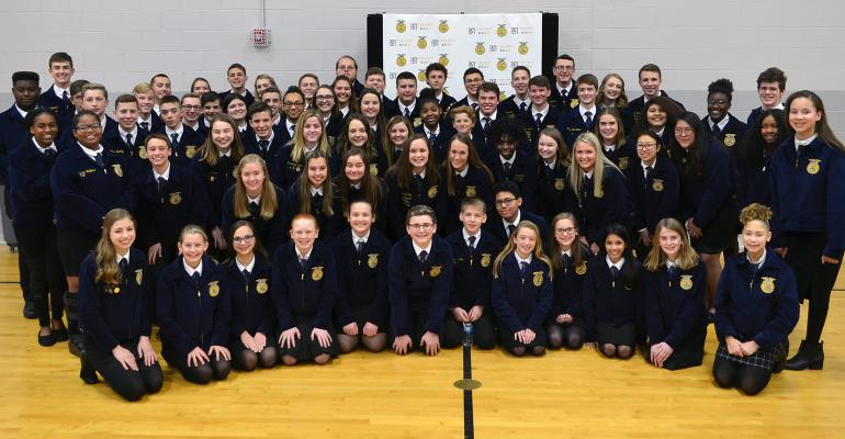 Members of the Global Impact STEM Academy FFA chapter pose with the National FFA officer team