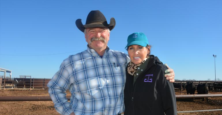 Mark and Eva Gardiner are shown in front of the confinement pens at the Henry and Nan Gardiner Marketing Center