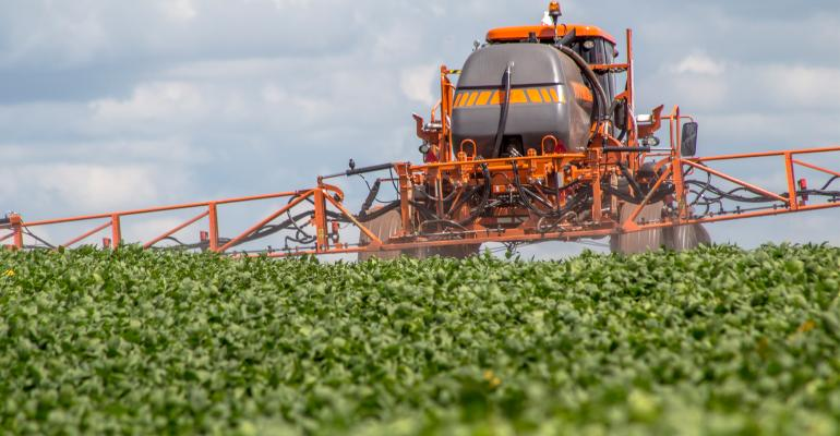 sprayer in soybean field