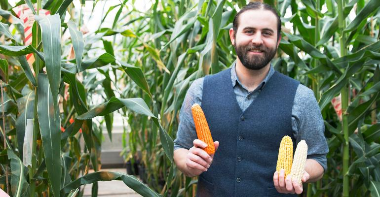 Evan Rocheford holds ears of corn
