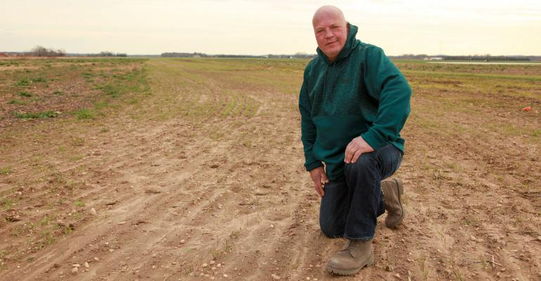 Allan Zilnicki, a third-generation farmer on Long Island, shown in family's potato field