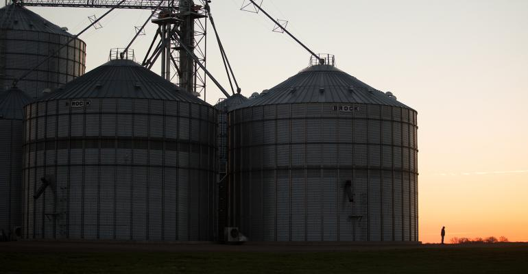 silhouette of grain bins