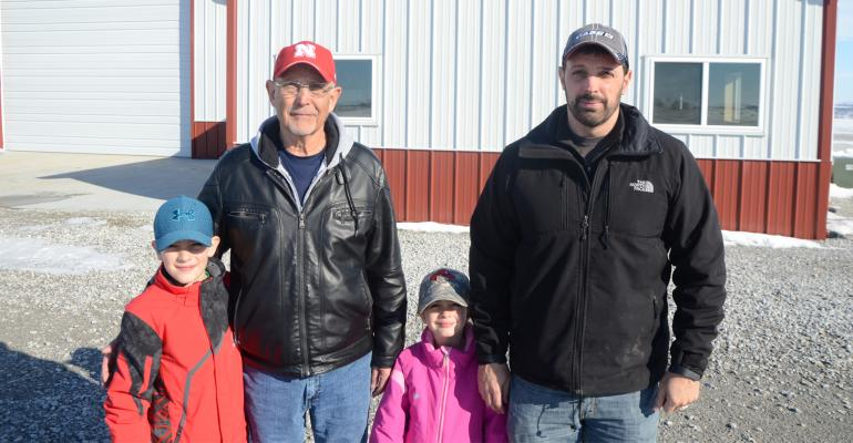 Gary and Randy Reinke, and Randy's son Blake and daughter Annalise stand outside the Reinkes' farm shop in Otoe County