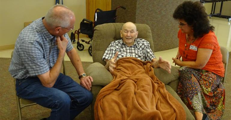 Karl Siebert, left and his wife, Carol, right visit with his uncle John G. Siebert during a family reunion shortly before his death.