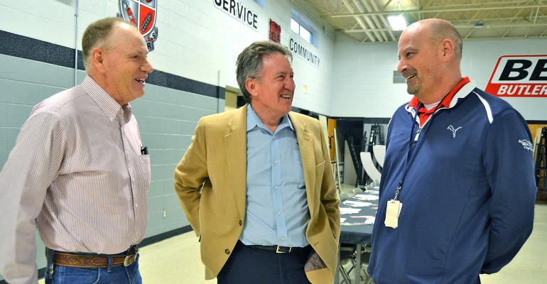Mark Russell (center), Missouri Beef Industry Council, talks with beef producer David Warfield (left) and school superintendent Darin Carter
