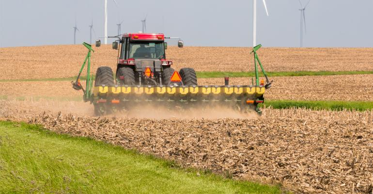 Planter working in corn field