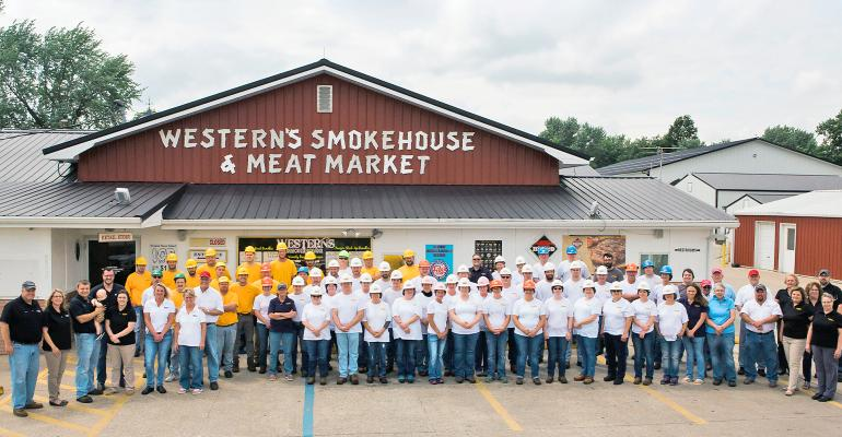 Employees of Western's Smokehouse Production, LLC, in Greentop, Mo.,