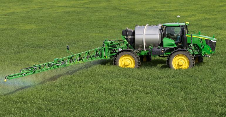 John Deere R4060 sprayer in field