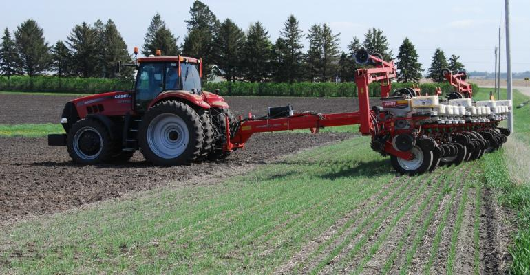 planter sitting idle in a crop field