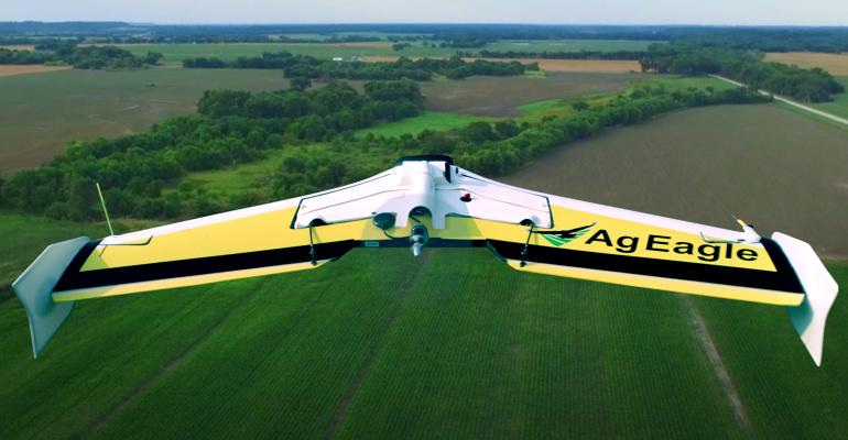 """AgEagle """"FlyingWing"""" flying over a wheat field"""