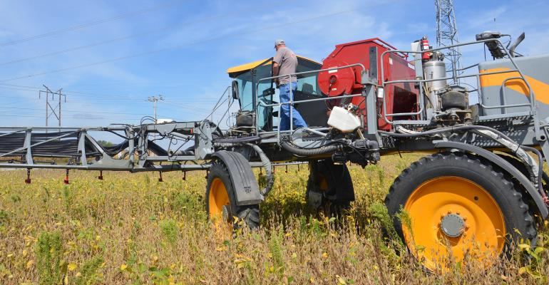 high-clearance seeder planting cover crops into standing cash crop