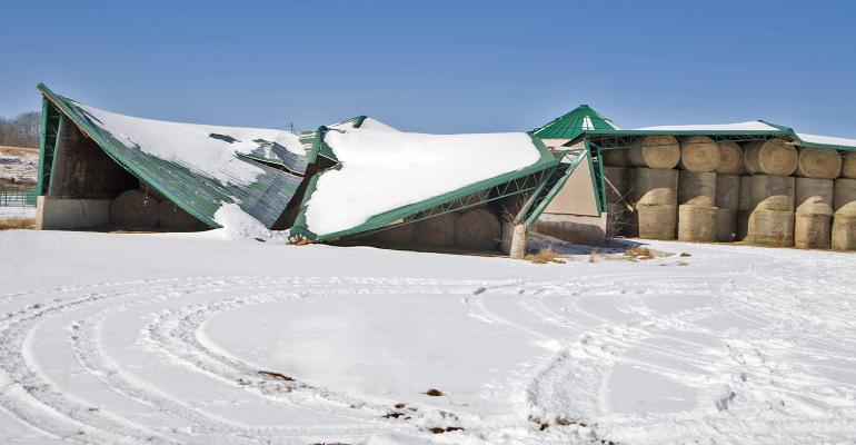 collapsed barn roof due to heavy snow