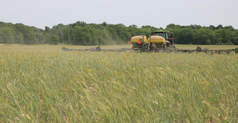 tractor planting corn into cereal rye