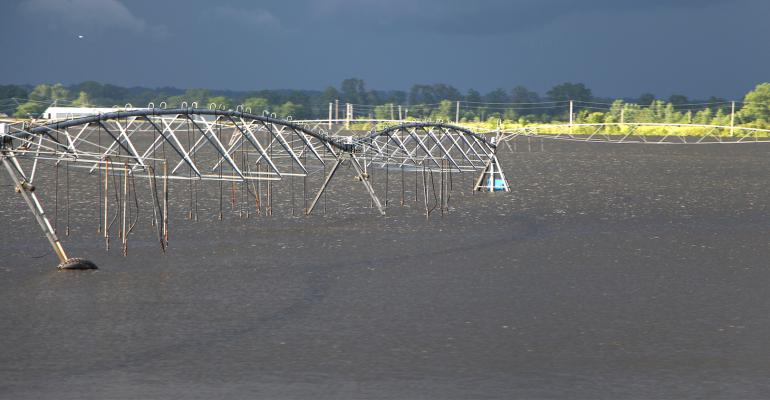irrigation system sits idle in flooded field
